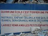 Табличка на здании школы о.Жана: