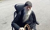 О.Иов в новом инвалидном кресле