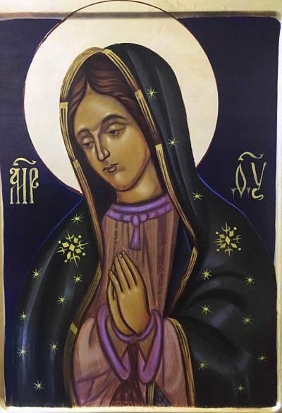Братия молится о помощи Гваделупской иконе Божией Матери, написанной на православный манер.